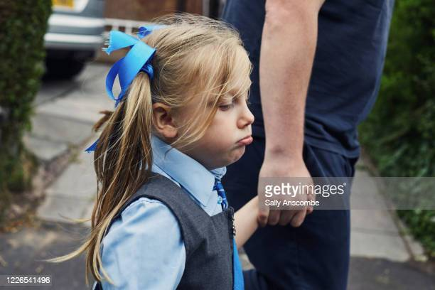school child getting ready for school - school uniform stock pictures, royalty-free photos & images