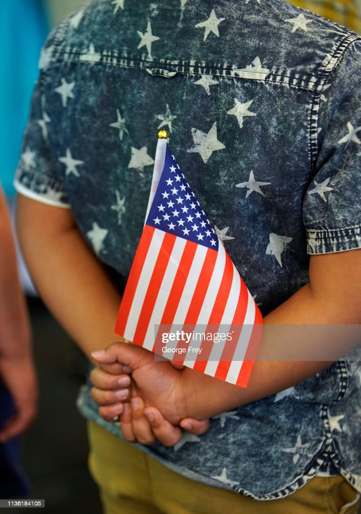 Over 60 Immigrants Are Sworn-In As U.S. Citizens In Salt Lake City Naturalization Ceremony : News Photo