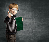 School Child in Glasses Thumbs Up, Kid Boy Hold Book