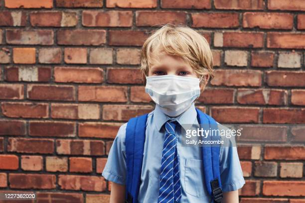 school child wearing a face mask - uk stock pictures, royalty-free photos & images