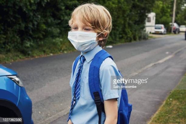 school child wearing a face mask - education stock pictures, royalty-free photos & images