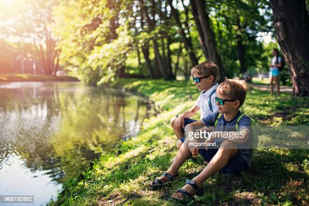 school children after school - pond stock pictures, royalty-free photos & images
