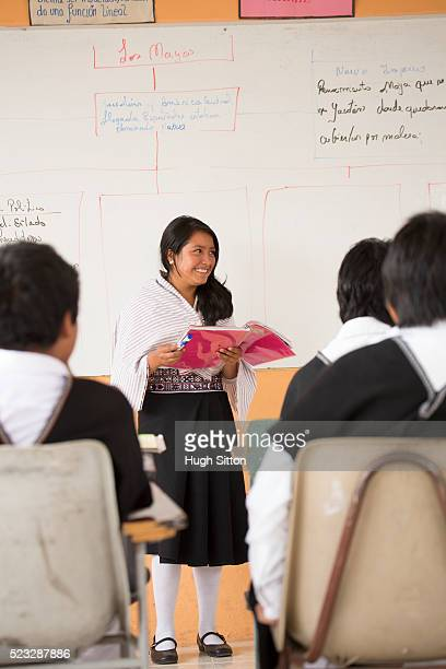 school children (6-7) and female teacher wearing traditional ecuadorian costume, ecuador - hugh sitton stock-fotos und bilder