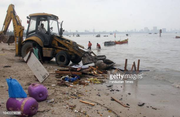 People participate in a beach cleanup drive a day after Ganpati immersion at Dadar beach on September 24 2018 in Mumbai India