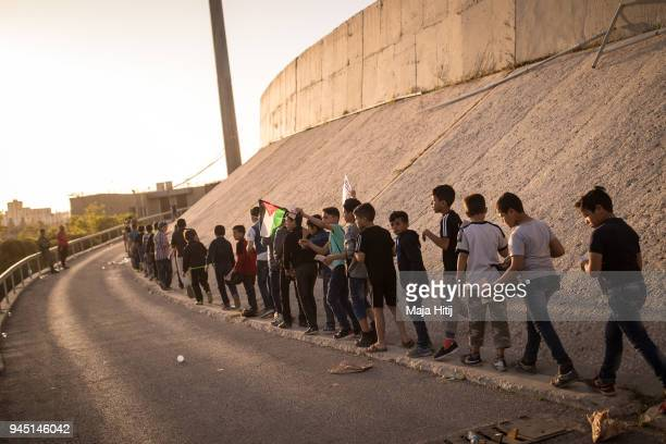 School children are queuing around Amman Stadium to watch the opening match of the AFC Asian Cup between the Jordanian National Womens Football Team...