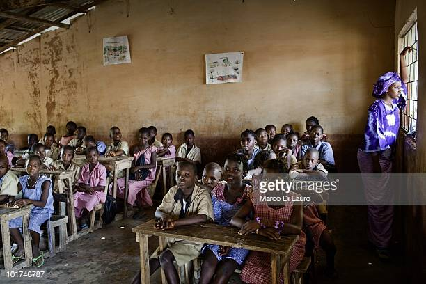 School children are seen during British Actor and UNICEF Ambassador James Nesbitt visits to the school and health center of the Maferinyah Village on...