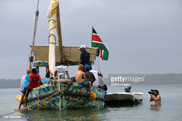 School children are seen getting updates about the FlipFlopi boat from Ali Skanda the boat builder during the 'Zanzibar' Expedition in Kilifi The...