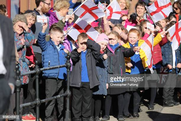 School children await the arrival of Prince Charles Prince of Wales at Langwathby Railway Station as he starts his visit to Cumbria and the Lake...