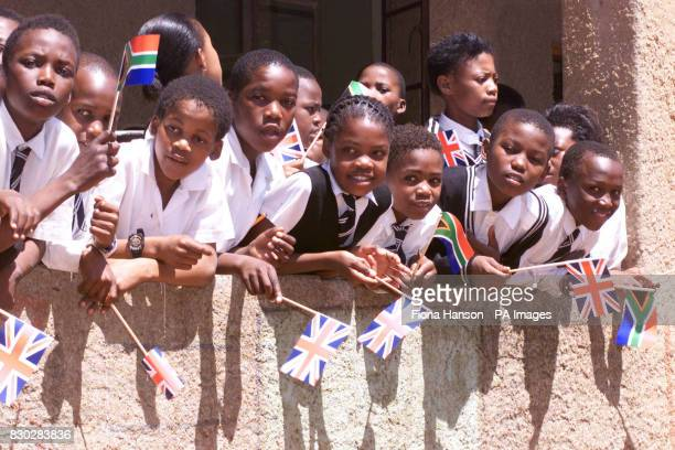 School children await the arrival of the Queen in Alexandra Township South Africa
