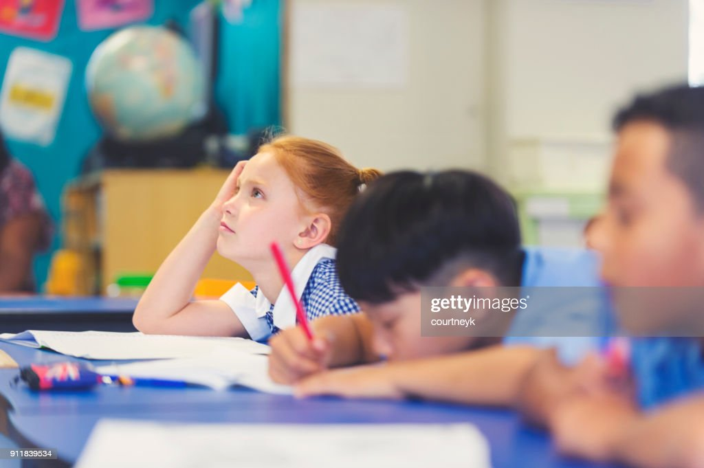 School children bored and tired in class. : Stock Photo