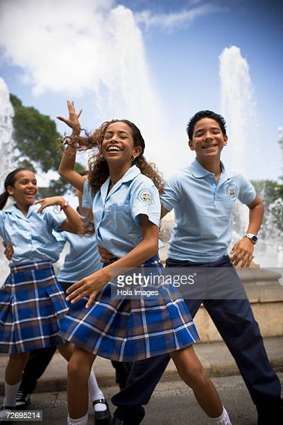 school children dancing salsa in center plaza - patio de colegio imagens e fotografias de stock