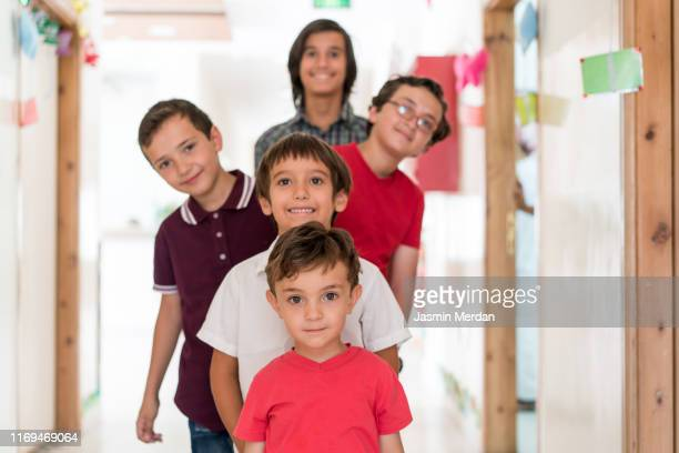 school children different ages group portrait - generation gap stock pictures, royalty-free photos & images