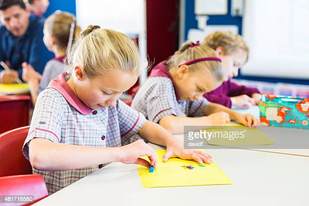 School Children Doing Drawings in the Classroom