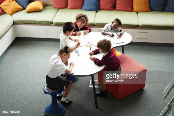School children drawing at the library