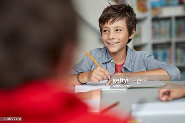 school children drawing at the school library - schulheft stock-fotos und bilder