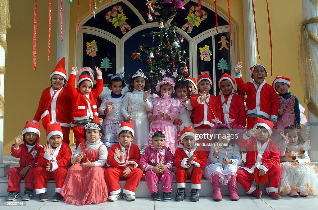 School Children dressed as Santa Claus celebrating Christmas at... News Photo - Getty Images