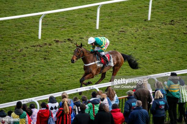 School children dressed in racing silks look on as Barry Geraghty riding Ok Corral win The Commission Free Racing At Matchbook Novices' Hurdle Race...