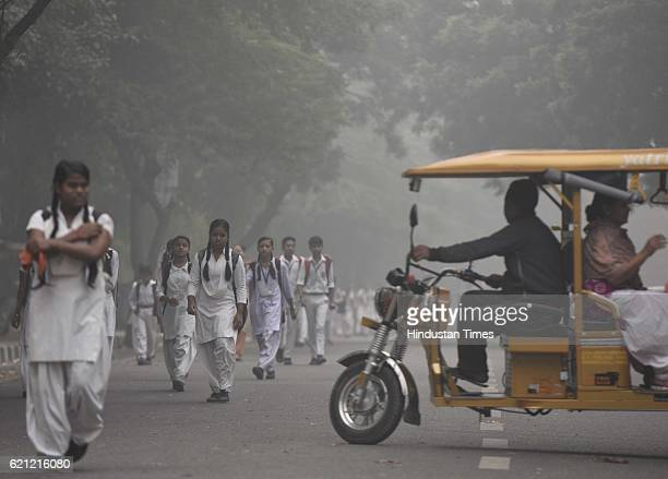 School children during a foggy morning as the whole city is engulfed in heavy smog air quality deteriorated sharply overnight leading to poor...
