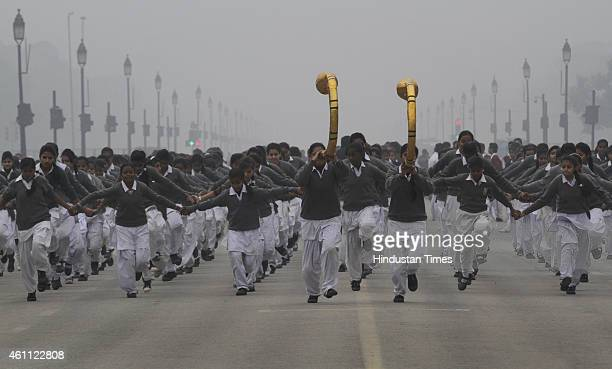 School children during their rehearsal for the Republic Day Parade in a cold and foggy morning at Rajpath on January 7 2015 in New Delhi India...