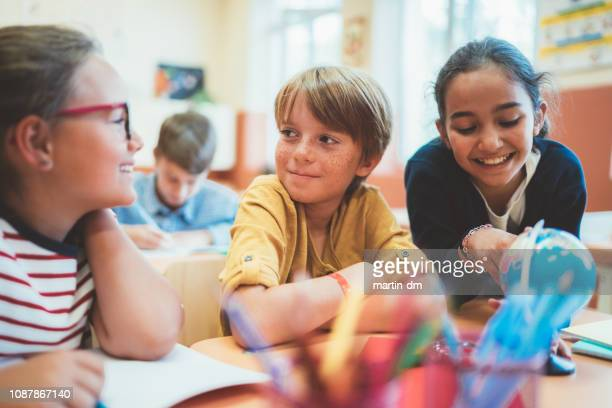 school children enjoying a geography lesson - children only stock pictures, royalty-free photos & images