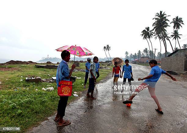 School children enjoys the arrival of Monsoon as Kerala witnessed monsoon rains on Friday in Kovalam India on June 05 2015 School reopening in Kerala...