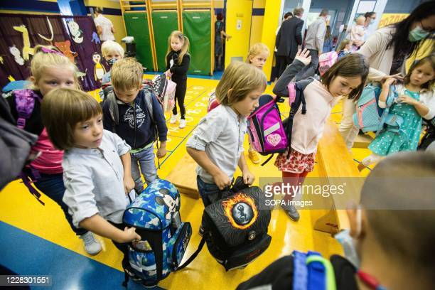 School children enter a classroom during the first day of the new school year Despite a rise in COVID19 infections after summer vacations the...