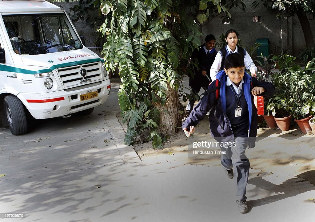 School Children evacuating their school building during a mock drill held at Birla Vidya Niketan, South Delhi on December 4,2102 in New Delhi, India. Mock Drill performs at various place in the capital to test the alertness and responds during the time of emergency situation such as Earthquake, Fire, Bomb Blast.