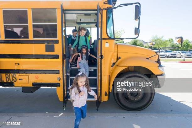 school children exit school bus - first day of school stock pictures, royalty-free photos & images