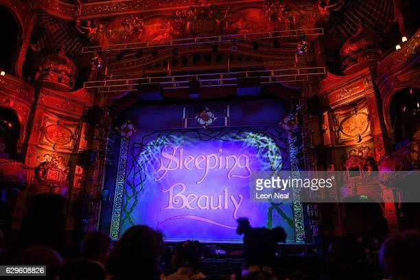School children file into their seats ahead of a performance of the traditional pantomime Sleeping Beauty at the Hackney Empire on December 13 2016...