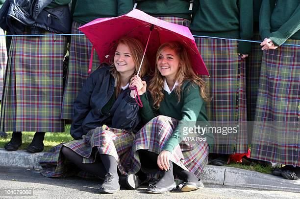 School children Flora Litchfield and Natalie De Jong await the arrival of Queen Elizabeth II, who is visiting Gordonstoun School, where she will open...