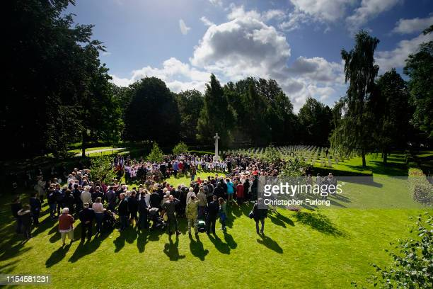 School children from the Normandy village of Cambesen Plaine read a poem to DDay veterans befire they placed flowers at the graves of all the fallen...