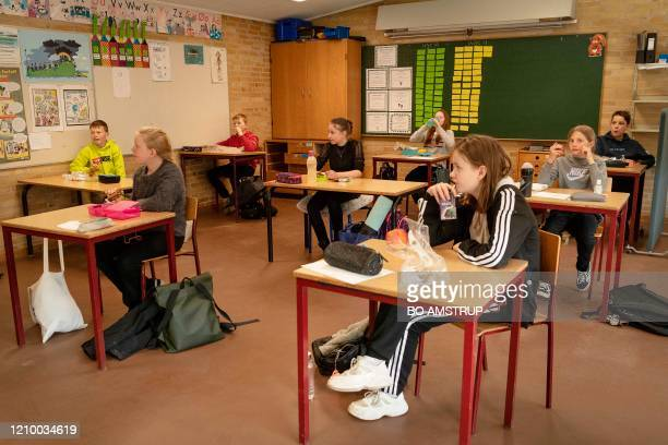 School children have their lunch during thier lunch break at the Korshoejskolen Public school in Randers Denmark on April 15 2020 Denmark began...