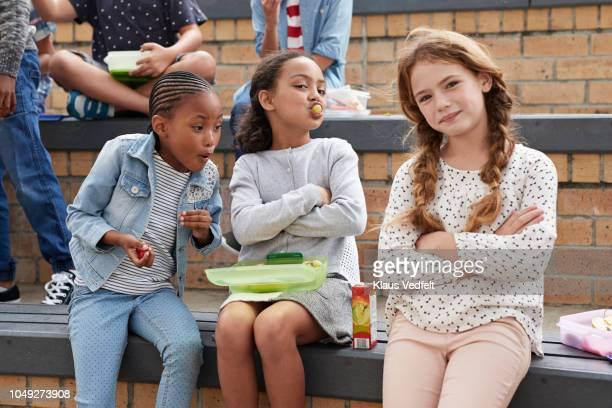 school children having lunch together outside the building - pre adolescent child stock pictures, royalty-free photos & images