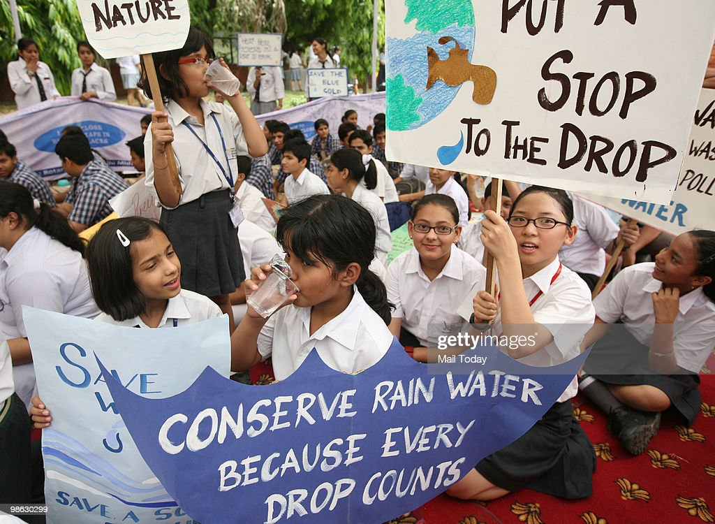 School children hold placards at a World Earth Day rally organised by UNESCO and WWF in New Delhi on April 22, 2010.