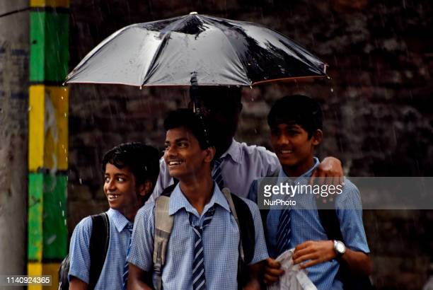 School children holds an umbrella in Kolkata on 03 May 2019 as the cyclonic storm Fani hits the coastal places of Orissa and West Bengal on 03 May...