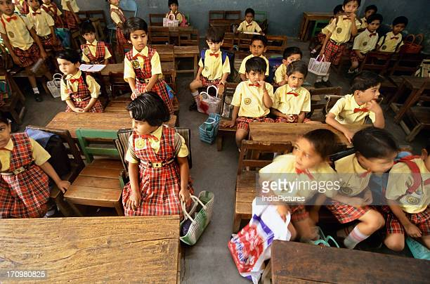 School children in a classroom on the last day of class Nagpur Maharashtra India