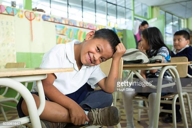 school children (6-7) in classroom, ecuador - ecuador fotografías e imágenes de stock