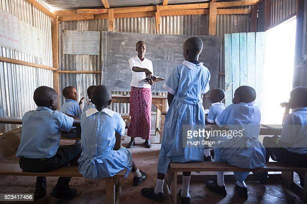school children in classroom. kenya. - hugh sitton photos et images de collection