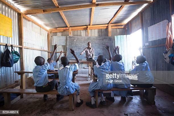 school children in classroom. kenya. - hugh sitton stock pictures, royalty-free photos & images