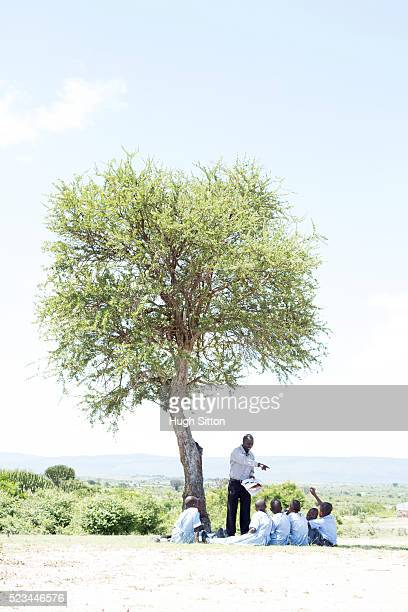 school children in classroom. kenya. - hugh sitton bildbanksfoton och bilder