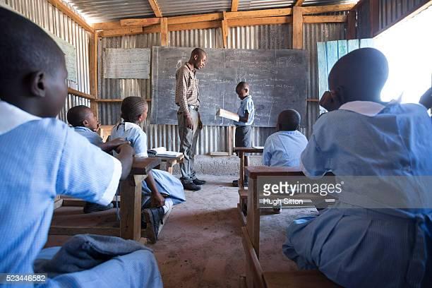 school children in classroom. kenya. - hugh sitton stock-fotos und bilder