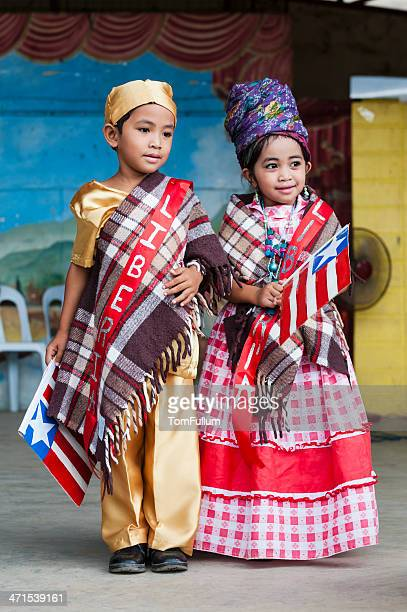 school children in costume - filipino culture stock photos and pictures