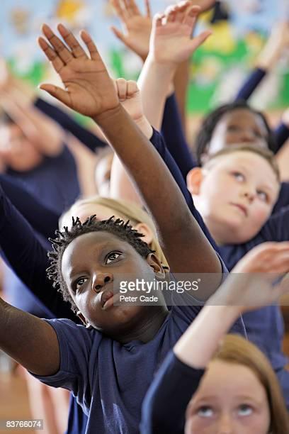 school children in drama class