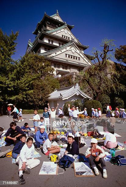 School children in front of a castle, Osaka Castle, Osaka, Japan