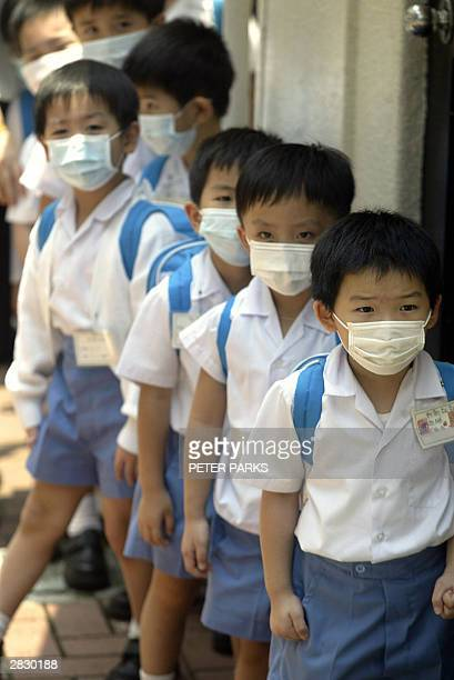School children in Hong Kong still wear masks to protect against SARS even though it is the seventh consecutive day of zero infections in the...
