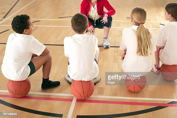 school children in physical education class - pe teacher stock photos and pictures