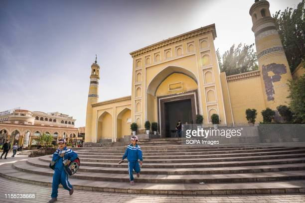 School children in their school uniforms seen in front of the Id Kah Mosque in Kashgar The Xinjiang province is located in the North Western part of...