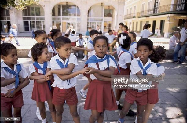 School children in their uniforms playing games Havana Cuba