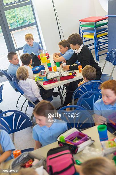 School Children in Uniform Eating Their Lunch Indoors