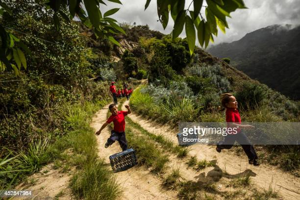 School children jump hurdles constructed of Pepsi crates during gym class at Culebrilla elementary school in Culebrilla Venezuela about 20 kilometers...